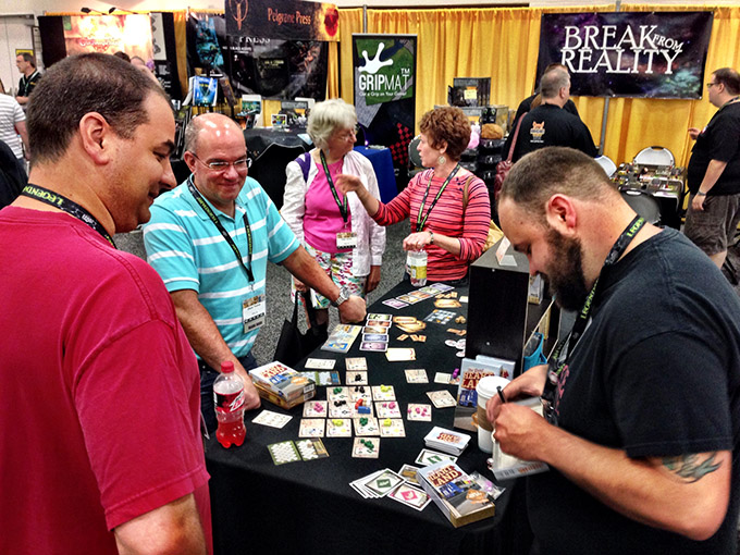 The Great Heartland Hauling Co. designer Jason Kotarski signs a copy for a fan. We sold out of the game in a day and a half!