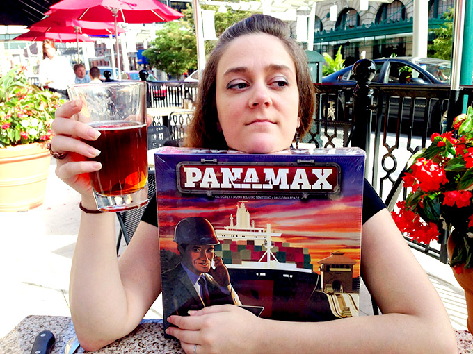 Here Stephanie Straw models two of her true loves - beer and Stronghold Games titles.
