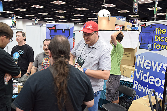 Here we see a wild Tom Vasel in his native environment - greeting fans in the Dice Tower booth.