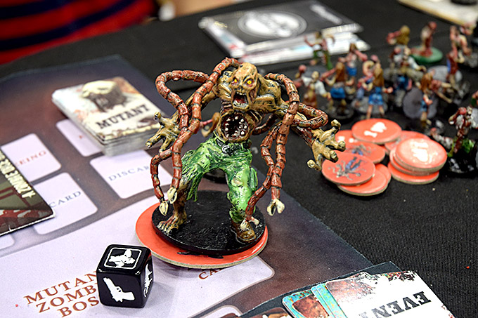 One great thing about Launius is that he takes time to pimp out all of his demo copies by hand-painting all the miniatures. Here we see a close-up of the huge mutant zombie boss for Run, Fight, or Die.