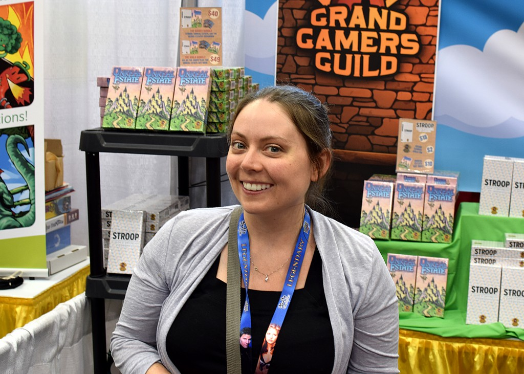 Heather Newton, marketer extraordinaire, selling tons of copies in the Grand Gamers Guild booth.