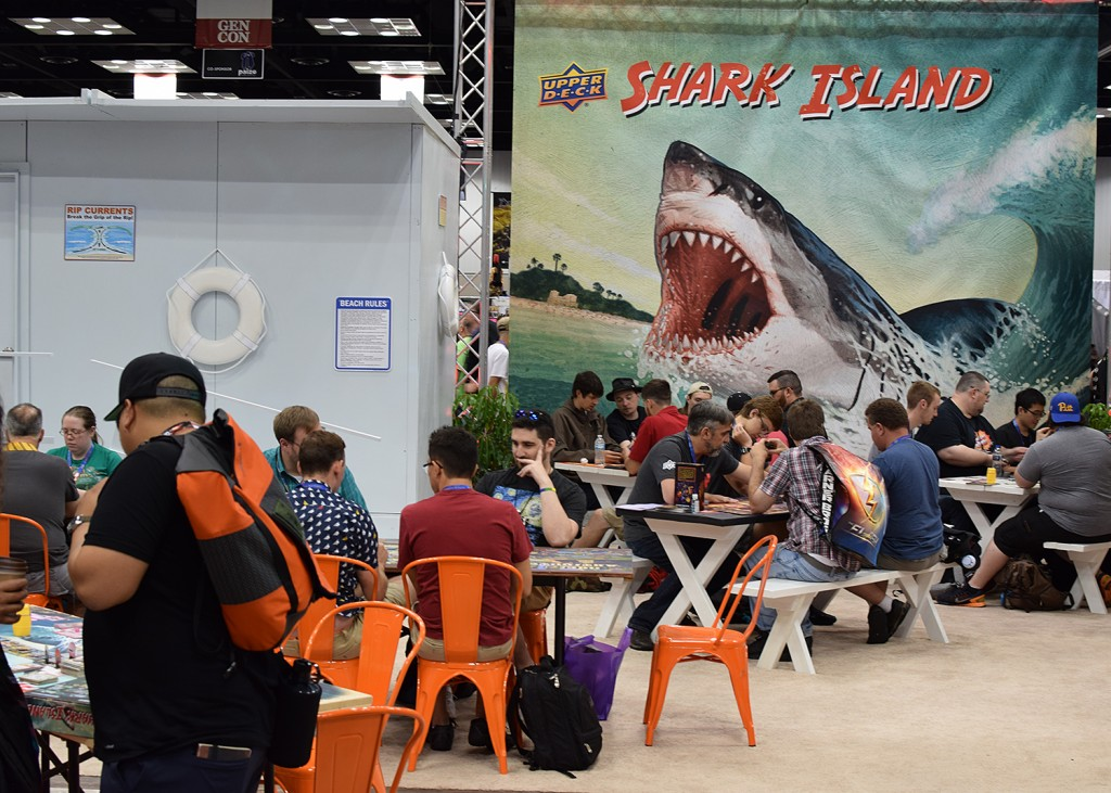 One of the most ridiculous booths (and games) at Gen Con was Upper Deck's Shark Island, complete with beach music, a lifeguard shack, and cabanas!