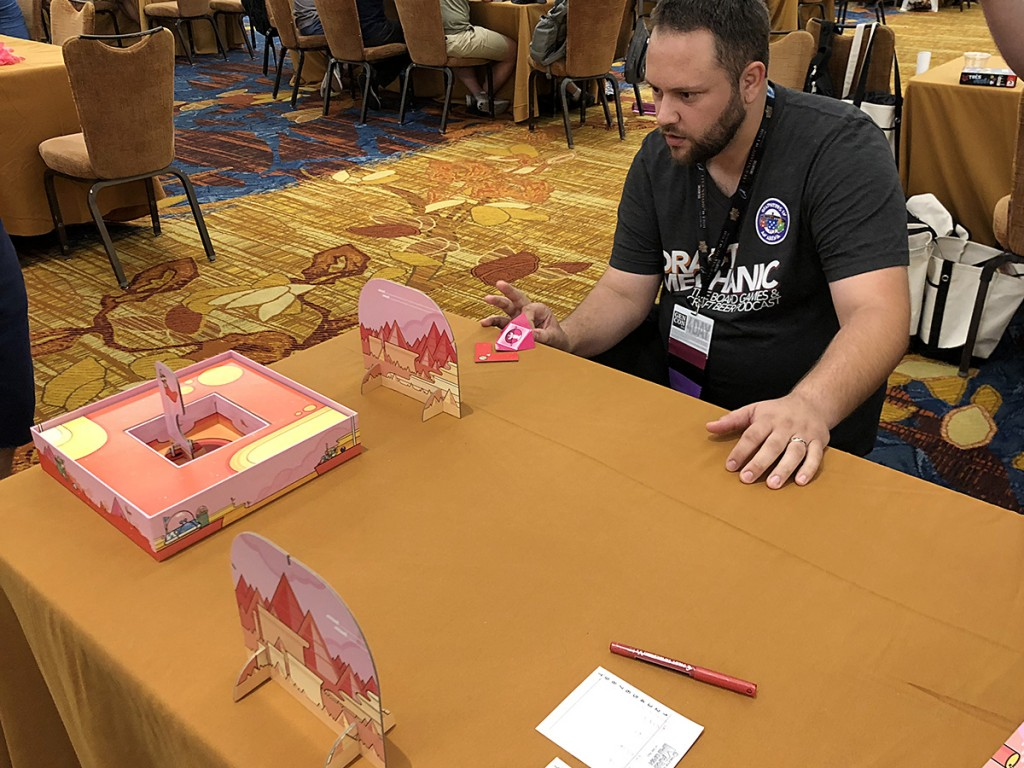 I got a chance to play Mars Open from Bellwether Games. Essentially, it's table golf with a paper football-type ball that hangs and floats as if you're in a lower-gravity environment. Here you can see Jake Bock from the Draft Mechanic podcast lining up his shot. He was a total shark.