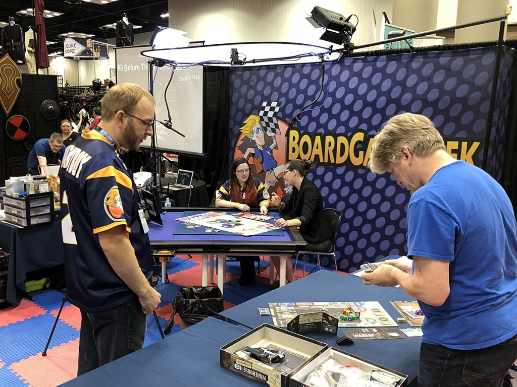 Our exhibit hall neighbors this year were the wonderful people at BoardGameGeek. Here, you can see Chad Krizan prepping another preview guest while Steph Hodge conducts interviews!