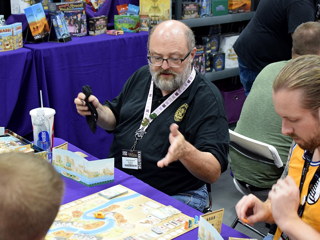 The incomprable David MacKenzie explaining how to play his newly-released Sailing Toward Osiris in the Daily Magic Games booth.