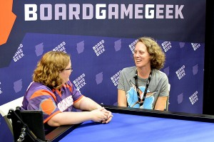Wingspan designer Elizabeth Hargrave doing an interview in the Boardgamegeek booth.