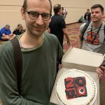 We got a chance to attend Portal Games' 20th anniversary party. Here, Ignacy Trzewiczek  shows of his anniversary cake.