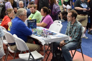 Designers Ken Franklin and Jay Treat checking out SpyMaster in the Calliope Games booth.