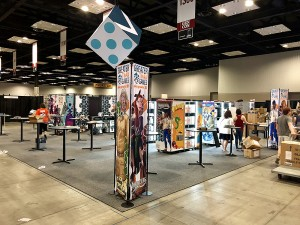 The Greater Than Games booth during set-up on Wednesday.